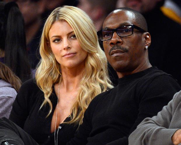 Actor Eddie Murphy and his girlfriend 33-year old Australian model Paige Butcher attend the NBA basketball game between the Los Angeles Lakers and the Phoenix Suns at Staples Center in 2012. (Kevork Djansezian/Getty Images)