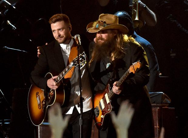 Musician Justin Timberlake (L) performs onstage with Singer-songwriter Chris Stapleton (R) at the 49th annual CMA Awards. (Rick Diamond/Getty Images)