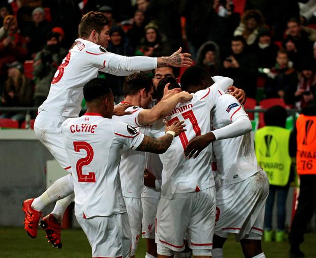 Liverpools team players celebrate their goal against Rubin during their Europa League Group B soccer match in Kazan, Russia, Thursday, Nov. 5, 2015. (AP Photo/Nikolai Alexandrov)