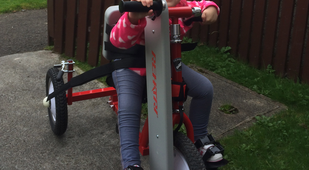 Kaylee with her new hand-cycle