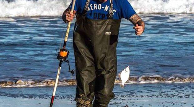Landed: An angler lands a small flat fish during the Culdaff SAC Open Shore competition in Donegal