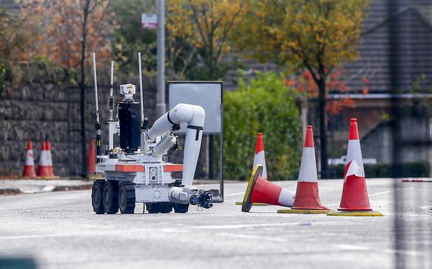 An Army report at the scene of a security alert at the Woodvale Road junction with Woodvale Parade. Pic Kevin Scott/Presseye