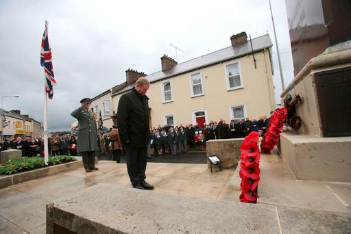 Taoiseach Enda Kenny lays a wreath as crowds gather for Remembrance Sunday at the Cenotaph in Enniskillen, Co Fermanagh. Niall Carson/PA Wire.