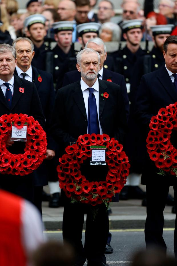 Labour party leader Jeremy Corbyn (centre) alongside Prime Minister David Cameron prepare to lay wreaths during the annual Remembrance Sunday service at the Cenotaph memorial in Whitehall. Gareth Fuller/PA Wire.