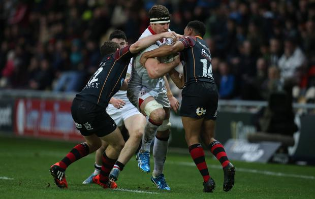Robbie Diack of Ulster takes on Adam Warren and Ashton Hewitt of Newport Gwent Dragons. Picture by Gareth Everett / Huw Evans /Press Eye.