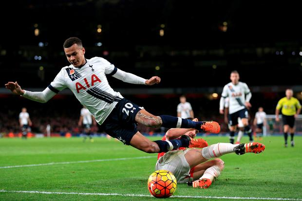 Arsenal's Mathieu Debuchy (right) battles for the ball with Tottenham Hotspur's Dele Alli during the Barclays Premier League match at the Emirates Stadium, London. Nigel French/PA Wire.