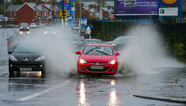 Flooding on the Andersonstown Road in west Belfast after heavy rain on Sunday. (Photo by Kevin Scott / Presseye)