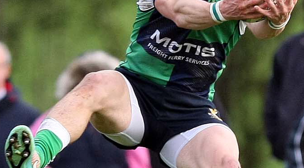 On the ball: Kelvin Hamilton of Ballynahinch takes possession