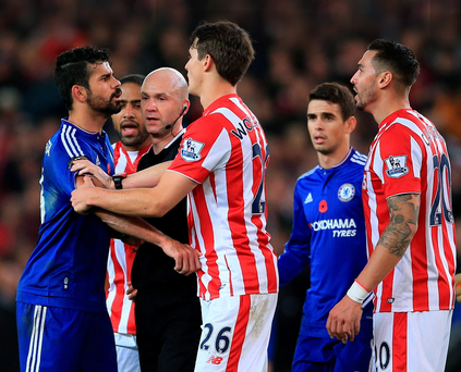 Getting heated: Diego Costa is separated from Stoke ace Geoff Cameron after a coming together at the Britannia Stadium