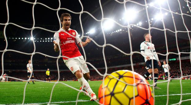 Net bonus: Mathieu Flamini shows his delight as Kieran Gibbs' effort draws Arsenal level