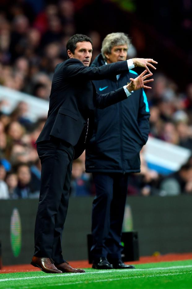 In charge: Remi Garde and Manuel Pellegrini walk the line