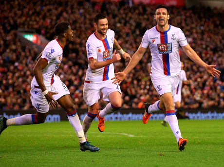Done and dusted: Crystal Palace's Scott Dann (right) celebrates hitting the winner at Anfield