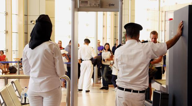 Security personnel wait to screen passengers departing Sharm el-Sheikh International Airport, south Sinai, Egypt, Friday, Nov. 6, 2015. Hundreds of British tourists stranded in the Egyptian resort from where a doomed Russian plane took off last weekend, waited anxiously Friday for flights home as budget carrier easyJet said the Egyptian government had disrupted its plans to fly the Britons out of Sinai. (AP Photo/ Vinciane Jacquet)