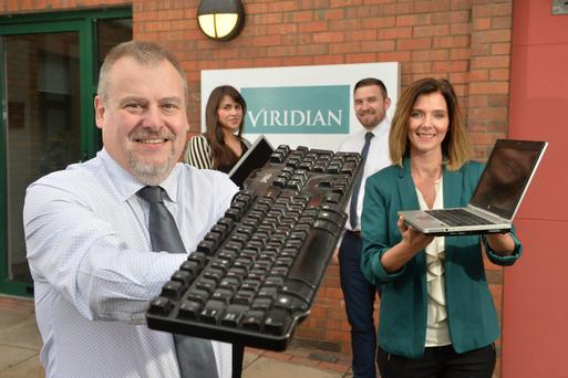 Viridian Group, independent energy provider in the all-Ireland market, is creating 35 new IT jobs. Pictured are: Paul Comins, Project Manager; Orlaith Murtagh, Business Analyst; Sean McCrea, Technical Lead and Catherine Gardiner, Group CIO. Photo by Aaron McCracken/Harrisons. Photo by Aaron McCracken/Harrisons