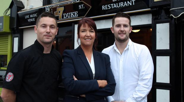 David Reynolds, director and Kris Fletcher, co-owner, outside Number 7 with Anne Morgan of Ulster Bank (centre)