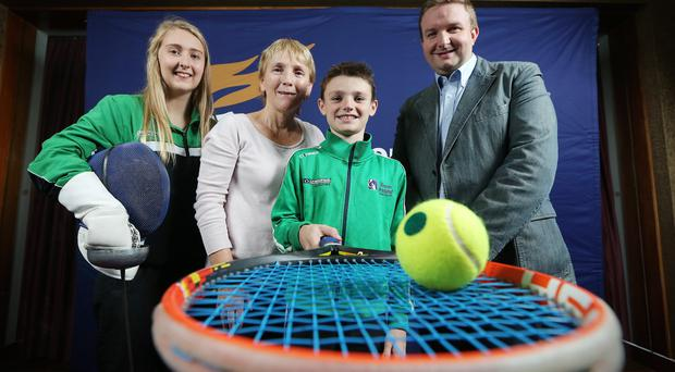 Helping hand: At the Mary Peters Trust Podium Programme event, supported by George Best Belfast City Airport, is fencer Rosie McGonagle, Eilish Rutherford, Chairman of the Mary Peters Trust, tennis player Dylan Leeman and Stephen Patton, Human Resources Manager at George Best Belfast City Airport