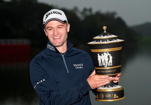 Up for the Cup: Russell Knox lifts the HSBC Champions trophy in Shanghai but it won't count towards Ryder Cup points