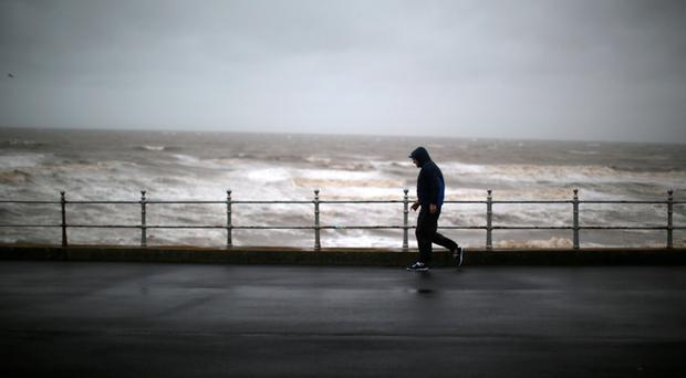 Strong winds and rain are predicted to cause havoc. Photo by Christopher Furlong/Getty Images