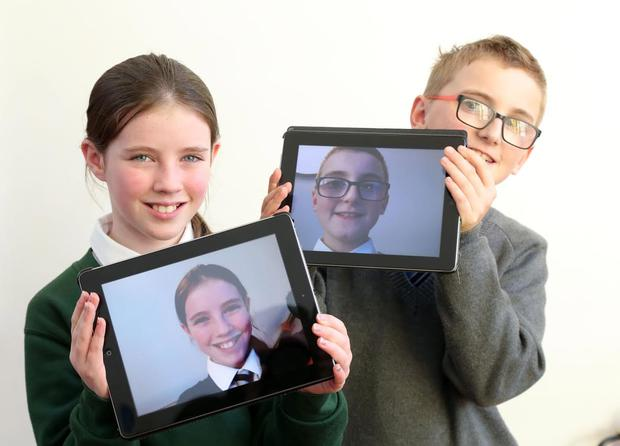 Pictured at the launch were: Niamh Taggart of St. Joseph's Primary School, Carryduff and Luke Hamilton of Gilnasirk PS who took part in the'Digital Schools of Distinction'. Picture by Darren Kidd / Press Eye