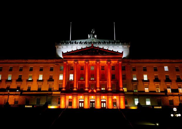 Stormont's Parliament Buildings have been illuminated in red for Armistice Day. Matt Mackey/Presseye