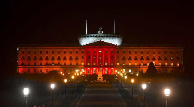 Stormont Parliament Buildings lit up red for Armistice Day in Belfast, Northern Ireland on November 11 2015 (Photo by Kevin Scott / Belfast Telegraph)