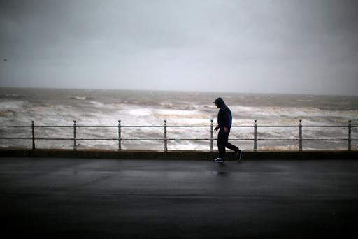 A man battles against driving rain and high winds in Blackpool, as Britain's first ever named storm, Storm Abigail, hits the North West on November 9, 2015 in Blackpool, England. (Photo by Christopher Furlong/Getty Images)