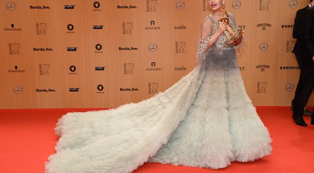 Rita Ora is seen with her award at the Bambi Awards 2015 winners board at Stage Theater in Berlin, Germany. (Clemens Bilan/Getty Images)