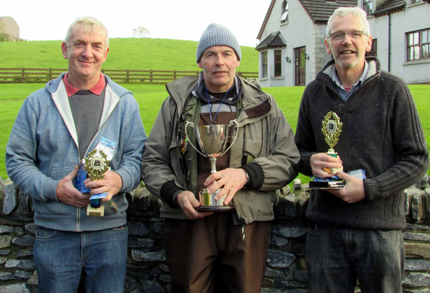 Great catch: The top three at the Cashel Trout Fishery Mickey V Perpetual Cup competition, runner-up John Hasson, winner Martin Bradley and third placed Tom Davies