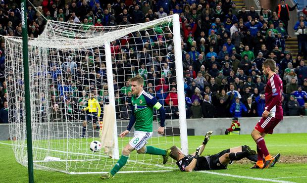 Northern Ireland's Steven Davis scores his side's first goal of the game during an international friendly against Latvia at Windsor Park, Belfast. Liam McBurney/PA Wire.