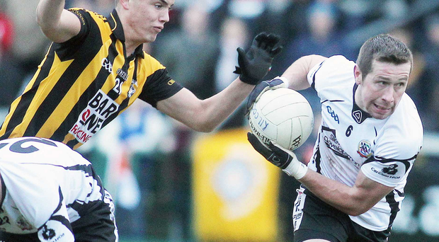 Crossmaglen's Mel Boyce in action against Kilcoo's Sean O'Hanlon