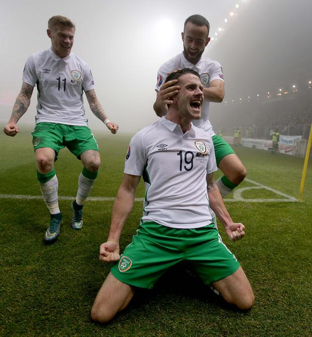 Striking it hot: Robbie Brady scores a crucial goal for the Republic of Ireland