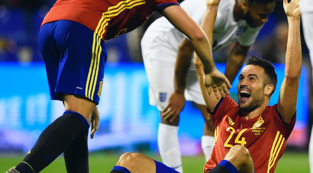 Get in: Spain's Mario Gaspar celebrates with Paco Alcacer Garcia after scoring the opener against England
