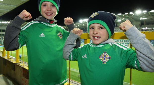 Backing the boys: Charlie and Noal Taylor from Lisburn get behind Michael O'Neill's men last night