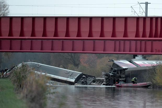 Rescuers work at the scene where a high-speed TGV train coach and engine carriage lie in a canal in Eckwersheim near Strasbourg, northeastern France, after derailing on November 14, 2015 during tests conducted by technicians, Frenh railway operator SNCF said. At least five were killed in French high-speed train test on November 14, due to excessive speed, sources said. AFP PHOTO / FREDERICK FLORINFREDERICK FLORIN/AFP/Getty Images