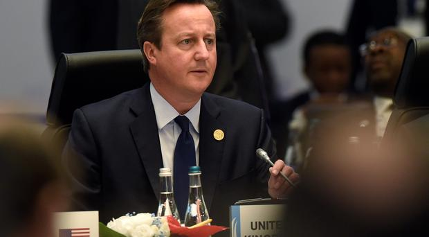 Britain's Prime Minister David Cameron attends a working session of the G-20 Summit in Antalya, Turkey, Sunday, Nov. 15, 2015. (AP Photo/Susan Walsh)