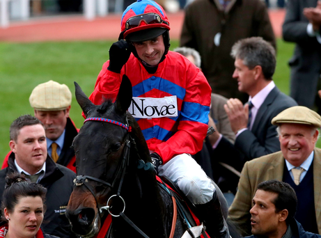 Victory salute: Nico de Boinville on Sprinter Sacre after winning the Shloer Chase at Cheltenham
