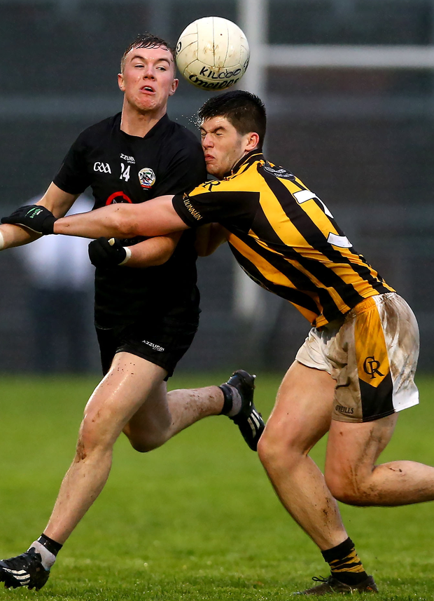 Close by: Kilcoo's Martin Devlin with Aidan Rushe