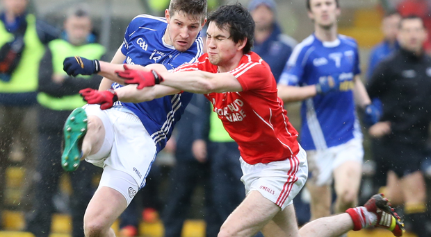 Fine margins: Darren Hughes of Scotstown clashes with Ruairi Kelly