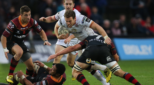 On the charge: Ulster's Darren Cave in action during a loss to Saracens