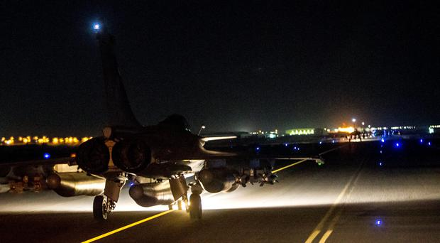A French army jet on the tarmac of an undisclosed air base as part of France's Operation Chammal launched in September 2015 in support of the US-led coalition against Islamic State group. France launched