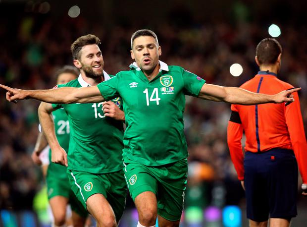 Ireland's striker Jonathan Walters (C) celebrates after scoring his team's first goal from a penalty during a UEFA Euro 2016 Group D qualifying second leg play-off football match between Ireland and Bosnia Herzegovina at the Aviva stadium in Dublin on November 16, 2015. AFP PHOTO / PAUL FAITHPAUL FAITH/AFP/Getty Images