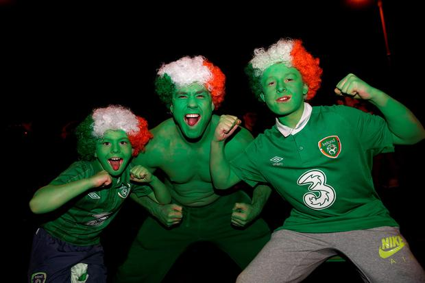 Republic of Ireland fans Shane Peppard (centre) with his son Clayton, aged 9, (left) and nephew Sean, 12, from Clondalkin during the UEFA Euro 2016 Qualifying Playoff second leg between Republic of Ireland and Bosnia and Herzegovina at the Aviva Stadium, Dublin. PA