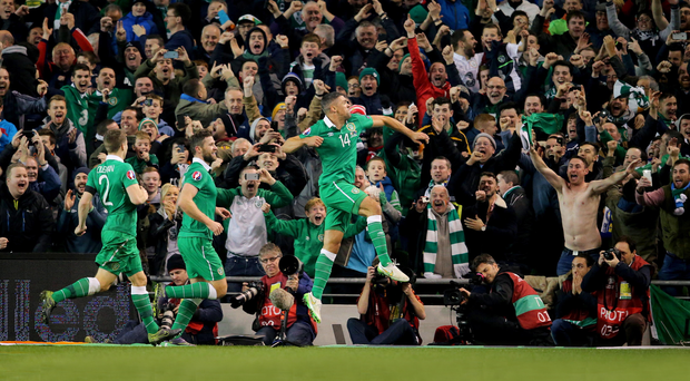 We're through: Republic of Ireland players and fans celebrate last night's historic victory