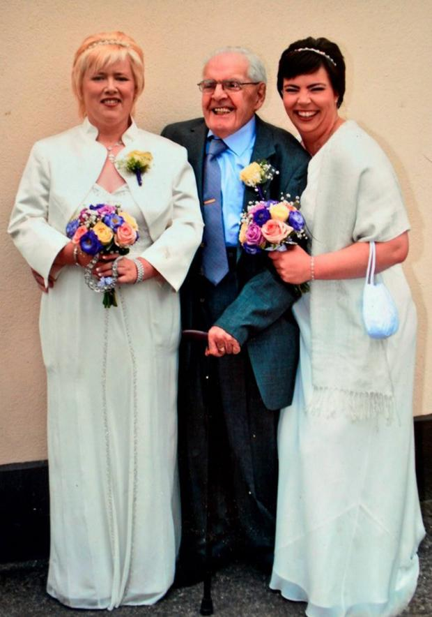 The couple with Dolores's father Con on the day of their civil partnership ceremony in 2011