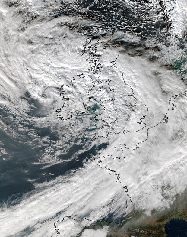 Satellite image issued by the University of Dundee of Storm Barney's cloud system blanketing the UK in an image received by the university's Satellite Receiving Station at 12.51 pm on Tuesday. PA