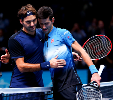 Familiar foes: Roger Federer embraces Novak Djokovic after his straight sets victory in the World Tour Finals at the O2 Arena