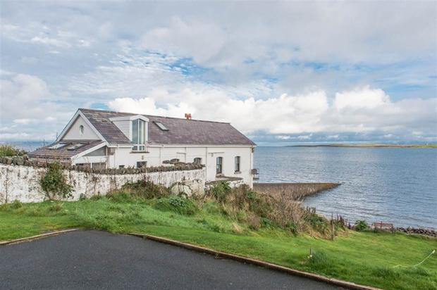 The former boathouse has breathtaking views of the Irish Sea, Copeland Islands and Scotland