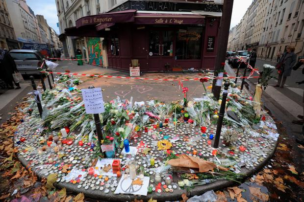 Tributes outside the Casa Nostra Cafe, one of the scenes of last friday's terror attacks, on November 16, 2015 in Paris, France. (Photo by Christopher Furlong/Getty Images)