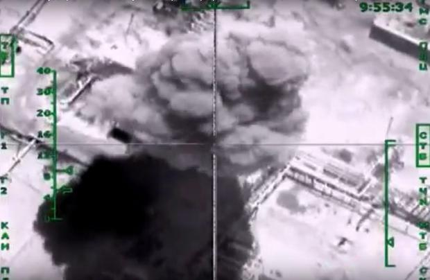 This photo made from the footage taken from Russian Defense Ministry official web site Wednesday, Nov. 18, 2015 shows oil refinement facilities hit during the attack of Russian warplanes in Syria. (AP Photo/Russian Defense Ministry Press Service)