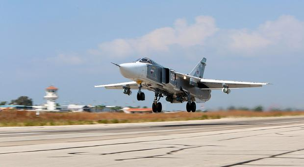 (FILES) A file picture taken on October 3, 2015 shows a Russian Sukhoi Su-24 bomber taking off from the Hmeimim airbase in the Syrian province of Latakia. Russian President Vladimir Putin pledged to step up air strikes in Syria after Moscow confirmed a bomb brought down a Russian passenger jet in Egypt last month, the Kremlin said on November 17. AFP PHOTO / KOMSOMOLSKAYA PRAVDA / ALEXANDER KOTS *RUSSIA OUT*ALEXANDER KOTS/AFP/Getty Images